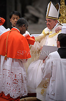 Haitian cardinal Chibly Langlois  receives his beret as he is being appointed cardinal by Pope Francis  at the consistory in the St. Peter's Basilica at the Vatican on February 22, 2014.