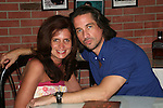 One Life To Live's Michael Easton poses with a fan on July 13, 2008 at Uncle Vinnie's Comedy Club in Point Pleasant, New Jersey. There was entertainment, q & a, and signing of photos and Michael's new book,. a graphic novel (which Melissa is holding) written by Michael and artwork by Christopher Shy. (Photo by Sue Coflin/Max Photos)