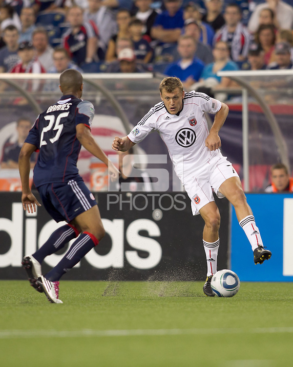 DC United forward Adam Cristman (7) attempts to control the ball as New England Revolution defender Darrius Barnes (25) closes. The New England Revolution defeated DC United, 1-0, at Gillette Stadium on August 7, 2010.