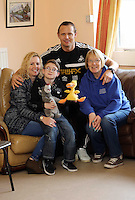 Pictured L-R: Volunteer Allison Morgan with 10 year old James Morris, Swansea City FC ambassador Lee Trundle and Diane Morris who is James' mother and also a volunteer. Monday 17 March 2014<br /> Re: Swansea City FC Ambassador, Lee Trundle has visited The Play and Leisure Opportunities Library (PLOL) to see how Comic Relief money is making a difference to vulnerable people in Swansea. The PLOL provides play sessions for children and adults with profound disabilities. A small Comic Relief grant has allowed the group to purchase and cover the insurance cost of sensory toys which they loan to families