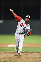 Lowell Spinners pitcher Enfember Martinez (13) delivers a pitch during a game against the Batavia Muckdogs on July 18, 2014 at Dwyer Stadium in Batavia, New York.  Lowell defeated Batavia 11-2.  (Mike Janes/Four Seam Images)