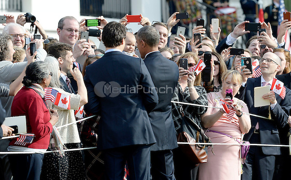 United States President Barack Obama and Prime Minister Justin Trudeau of Canada shakes hands with guests during an Official Arrival ceremony a the White House, March 10, 2016 in Washington, D.C.  <br /> Credit: Olivier Douliery / Pool via CNP/MediaPunch