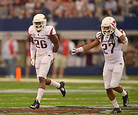 STAFF PHOTO BEN GOFF  @NWABenGoff -- 09/27/14 Arkansas defenders Rohan Gaines, left, and Alan Turner react after forcing a fourth down during the second quarter of the Southwest Classic at AT&T Stadium in Arlington, Texas on Saturday September 27, 2014.