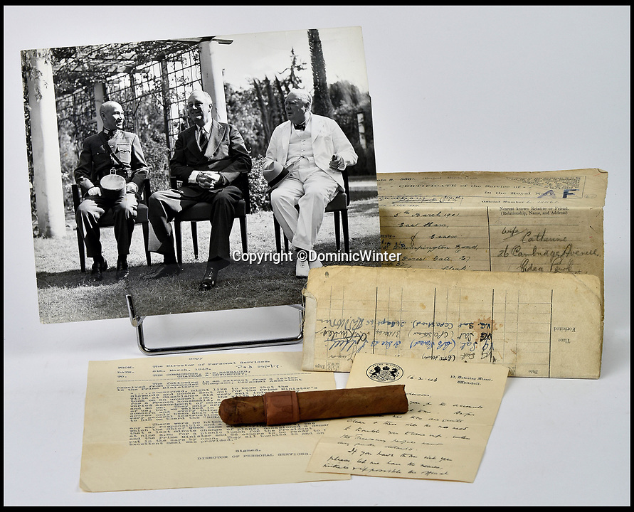 BNPS.co.uk (01202 558833)<br /> Pic:  DominicWinter/BNPS<br /> <br /> One of Churchill's trademark cigars and a photograph of Churchill alongside US President Franklin Roosevelt and the former President of China Chiang Kai-Shek at the Casablanca conference.<br /> <br /> Charming photos of Winston Churchill with his grandchildren have emerged for sale - alongside one of his trademark cigars.<br /> <br /> The candid snaps reveal Churchill enjoying the company of his wife Clementine and their grandchildren at Chartwell, their family home.<br /> <br /> They were taken in 1951, at which point he had just been re-installed as Prime Minister after a six year absence.<br /> <br /> The partly-smoked cigar was taken by a naval officer as a memento of the British wartime leader's stay on board HMS Pembroke in 1943.