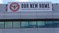 A sign on the outside of a building promotes Brentford's new stadium during Brentford vs Swansea City, Sky Bet EFL Championship Play-Off Semi-Final 2nd Leg Football at Griffin Park on 29th July 2020
