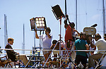 film production crew lighting a scene