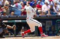 Philadelphia Phillies outfielder Juan Pierre #10 follows through during the Major League Baseball game against the Pittsburgh Pirates on June 28, 2012 at Citizens Bank Park in Philadelphia, Pennsylvania. The Pirates defeated the Phillies 5-4. (Andrew Woolley/Four Seam Images).