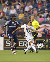 Pumas UNAM forward Juan Francisco Palencia (17) passes the ball as New England Revolution midfielder Shalrie Joseph (21) closes. The New England Revolution defeated Pumas UNAM in SuperLiga group play, 1-0, at Gillette Stadium on July 14, 2010.