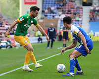 Preston North End's Joe Rafferty plays the ball past Wigan Athletic's Antonee Robinson<br /> <br /> Photographer David Shipman/CameraSport<br /> <br /> The EFL Sky Bet Championship - Wigan Athletic v Preston North End - Monday 22nd April 2019 - DW Stadium - Wigan<br /> <br /> World Copyright © 2019 CameraSport. All rights reserved. 43 Linden Ave. Countesthorpe. Leicester. England. LE8 5PG - Tel: +44 (0) 116 277 4147 - admin@camerasport.com - www.camerasport.com