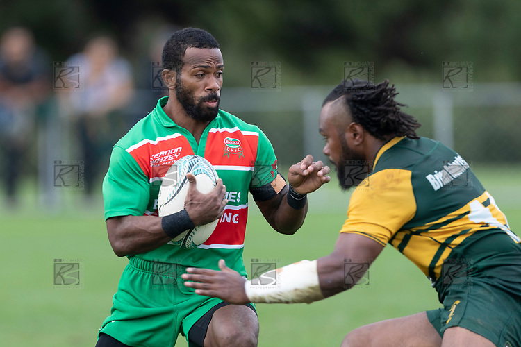 Leme Tulele is confronted by Rupeni Vosayaco. Counties Manukau Premier Club rugby game between Pukekohe and Waiuku, played at Colin Lawrie Fields, Pukekohe on Saturday April 14th, 2018. Pukekohe won the game 35 - 19 after leading 9 - 7 at halftime.<br /> Pukekohe Mitre 10 Mega -Joshua Baverstock, Sione Fifita 3 tries, Cody White 3 conversions, Cody White 3 penalties.<br /> Waiuku Brian James Contracting - Lemeki Tulele, Nathan Millar, Tevta Halafihi tries,  Christian Walker 2 conversions.<br /> Photo by Richard Spranger