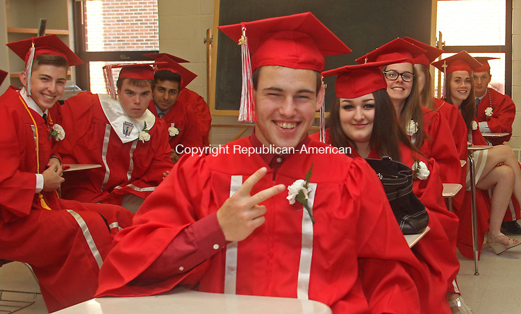 Southbury, CT-17 June 061714MK08  Grayson Slatermugs for the camera with his classmates while waiting to begin the Pomperaug Regional High School's commencement exercises Tuesday evening in Southbury. Michael Kabelka / Republican-American
