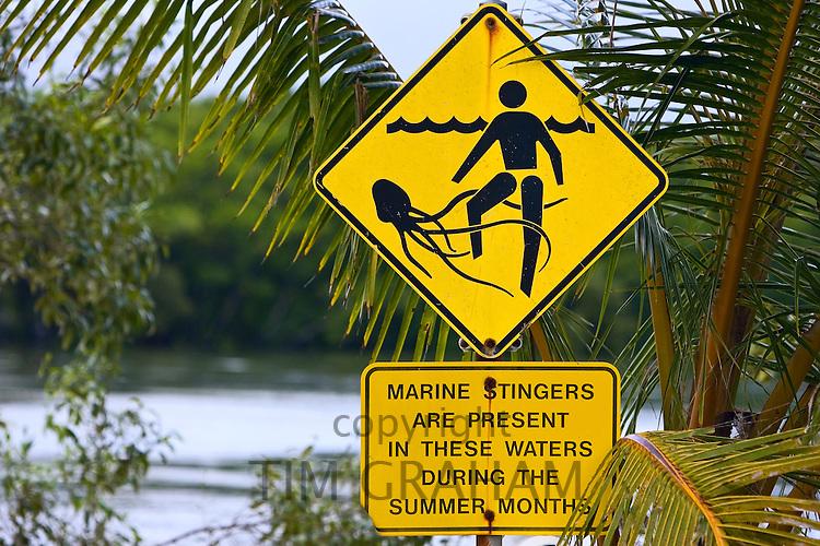 Marine stingers warning sign on Myall Beach by Cape Tribulation, Queensland, Australia