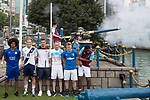 Aston Villa's Harry McKirdy fires the Noon Day Gun while (from left to right) Leicester City's Hamza Dewan Choudhury, Causeway Bay's Andrew Wylde, Cagliari Calcio's Vasco Oliveira, Olympique Marseille's Lucas Genty, Glasgow Rangers' Max Ambrose, and West Ham United's Moses Makasi pose for a photograph near the Noon Day Gun to celebrate the launch of the HKFC Citi Soccer Sevens 2017 on 25 May 2017 in Causeway Bay, Hong Kong, China. Photo by Chris Wong / Power Sport Images