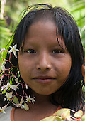Aldeia Baú, Para State, Brazil. Kayapo girl with flowers in her hair, smiling.