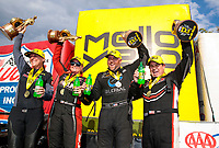 Sep 29, 2019; Madison, IL, USA; (From left) NHRA pro stock motorcycle rider Karen Stoffer, pro stock driver Erica Enders, funny car driver Shawn Langdon and top fuel driver Billy Torrence celebrate after winning the Midwest Nationals at World Wide Technology Raceway. Mandatory Credit: Mark J. Rebilas-USA TODAY Sports