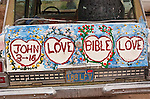 Back of the jeep painted by Leonard Knight artist and creator of Salvation Mountain by the Slabs near Niland, Calif...Leonard Knight is a gentle and friendly man who is sharing his passion for God with all comers in the Imperial Valley...Bible verse: John 3:16--Love Bible Love