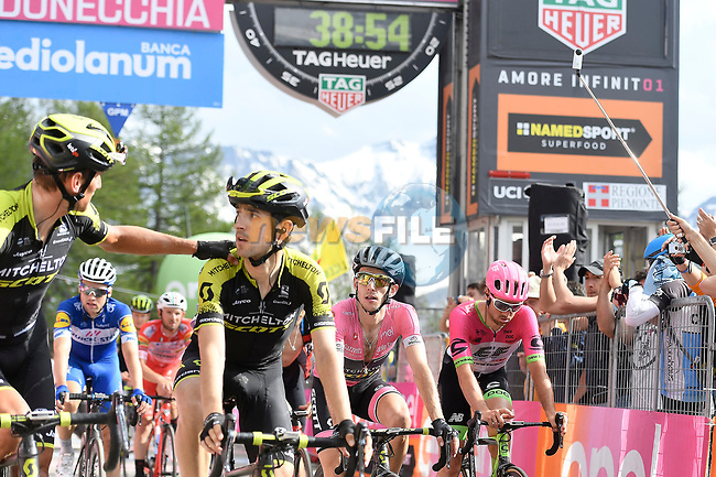 Race leader Maglia Rosa Simon Yates (GBR) Mitchelton-Scott loses 38 minutes as he crosses the finish line of Stage 19 of the 2018 Giro d'Italia, running 185km from Venaria Reale to Bardonecchia featuring the Cima Coppi of this Giro, the highest climb on the Colle delle Finestre with its gravel roads, before finishing on the final climb of the Jafferau, Italy. 25th May 2018.<br /> Picture: LaPresse/Fabio Ferrari | Cyclefile<br /> <br /> <br /> All photos usage must carry mandatory copyright credit (© Cyclefile | LaPresse/Fabio Ferrari)