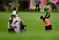 3rd round leader Pernilla Lindberg, of Sweden, hits her 2nd shot on the par 5, 13th hole with Sung Hyun Park of Korea watching, during the third round of the ANA Inspiration at the Mission Hills Country Club in Palm Desert, California, USA. 3/31/18.<br /> <br /> Picture: Golffile | Bruce Sherwood<br /> <br /> <br /> All photo usage must carry mandatory copyright credit (&copy; Golffile | Bruce Sherwood)during the second round of the ANA Inspiration at the Mission Hills Country Club in Palm Desert, California, USA. 3/31/18.<br /> <br /> Picture: Golffile | Bruce Sherwood<br /> <br /> <br /> All photo usage must carry mandatory copyright credit (&copy; Golffile | Bruce Sherwood)