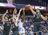 Washington, DC - March 11, 2018: Davidson Wildcats forward Will Magarity (22) blocks Rhode Island Rams guard Stanford Robinson (13) shot during the Atlantic 10 championship game between Rhode Island and Davidson at  Capital One Arena in Washington, DC.   (Photo by Elliott Brown/Media Images International)