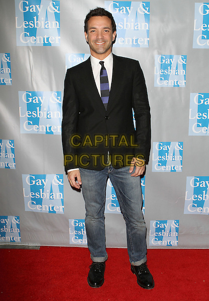 "GEORGE KOTSIOPOULOS .L.A. Gay & Lesbian Center's ""An Evening With Women"" held at The Beverly Hilton Hotel, Beverly Hills, California, USA..April 16th, 2011.full length black suit jacket jeans denim.CAP/ADM/KB.©Kevan Brooks/AdMedia/Capital Pictures."