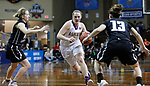 SIOUX FALLS, SD: MARCH 23:  Laina Snyder #3 of Ashland drives between Central Missouri defenders during their game at the 2018 Division II Women's Basketball Championship at the Sanford Pentagon in Sioux Falls, S.D. (Photo by Dick Carlson/Inertia)