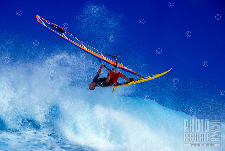 Windsurfing flying off the lip of wave at Hookipa beach, Maui