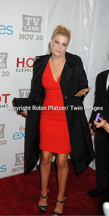 """Kristen Johnston in Antonio Teradi red dress attends the TV Land Party for the  premieres of """"Hot In Cleveland"""" and """"The Exes""""  on November 29, 2011 at SD26 in New York City. the party also celebrated Toys for Tots."""