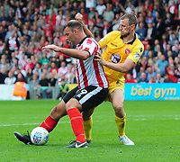 Lincoln City's Matt Rhead shields the ball from Morecambe's Dean Winnard<br /> <br /> Photographer Chris Vaughan/CameraSport<br /> <br /> The EFL Sky Bet League Two - Lincoln City v Morecambe - Saturday August 12th 2017 - Sincil Bank - Lincoln<br /> <br /> World Copyright &copy; 2017 CameraSport. All rights reserved. 43 Linden Ave. Countesthorpe. Leicester. England. LE8 5PG - Tel: +44 (0) 116 277 4147 - admin@camerasport.com - www.camerasport.com