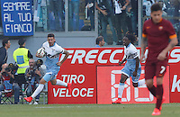 Calcio, Serie A: Lazio vs Roma. Roma, stadio Olimpico, 25 maggio 2015.<br /> Lazio's Filip Djordjevic, left, celebrates with teammate Luis Pedro Cavanda after scoring as Roma's Juan Iturbe, right, reacts during the Italian Serie A football match between Lazio and Roma at Rome's Olympic stadium, 25 May 2015.<br /> UPDATE IMAGES PRESS/Riccardo De Luca