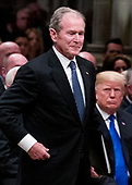 Former President George W. Bush walks past President Donald Trump to speak a State Funeral for President George H.W. Bush, at the National Cathedral, Wednesday, Dec. 5, 2018, in Washington. <br /> Credit: Alex Brandon / Pool via CNP