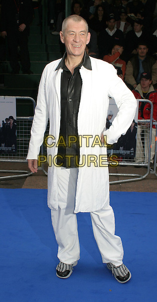 SIR IAN McKELLEN.Attending the X-Men 2 Premiere, Odeon West End, London..24th April 2003 .Ref: Ten.full length, full-length, white trousers, long white jacket, trainers.www.capitalpictures.com.sales@capitalpictures.com.©Capital Pictures