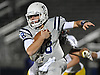Oceanside quarterback No. 18 Vincent Guarino runs the ball on a keep during a Nassau County varsity football Conference I semifinal against Massapequa at Hofstra University on Saturday, Nov. 14, 2015.<br /> <br /> James Escher
