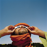 A Tuareg tribesman views the 2006 Eclipse, Libya