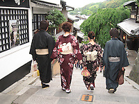 Kimonos in Kyoto. Japanese in traditional kimonos visit Kyoto's temples and shrines