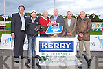 TOP DOG: Maurice O'Connor trainer of Deerfield Sings winner of the Kerry Group Hospital Sweepstake Final being presented with the winner trophy by Frank Hayes director of corporate affairs Kerry Group at the Friends of KGH Benefit meeting at the Kingdom Greyhound Stadium on Friday l-r: Declan Dowling (sales and operational manager KGS), Moss Leen (handler), Maurice O'Connor (trainer), Frank Hayes (director of corporate affairs Kerry Group), Tom McCormack (Friends of KGH) and Tom O'Connor (Friends of KGH).