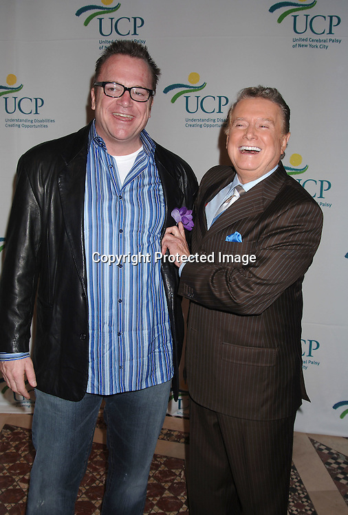 Tom Arnold and Regis Philbin..at The 5th Annual Women Who Care Luncheon benefitting ..United Cerebral Palsy of New York City on May 4, 2006 ..at Cipriani 42nd Street...Robin Platzer, Twin Images