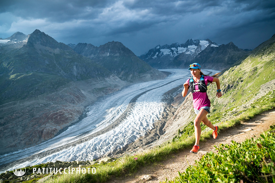 Trail running along the Aletschgletscher, the Alps largest glacier and UNESCO site, while doing the loop trail from Bettmeralp, Switzerland.