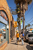 USA, California, portrait of Christine Kruttschnitt in Venice Beach walking down Abbot Kinney Boulevard in front of Altered Space Gallery