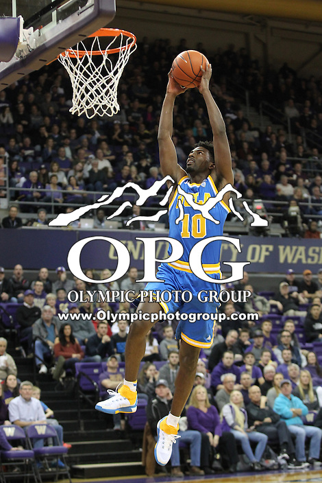 JAN 1, 2016:  UCLA's #10 Isaac Hamilton goes up for a break away slam dunk against Washington.  Washington defeated #25 ranked UCLA 96-93 in double overtime at Alaska Airlines Arena in Seattle, WA.
