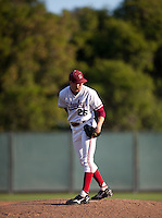STANFORD, CA - April 15, 2011: Mark Appel of Stanford baseball looks toward the runner at first during Stanford's game against Oregon State at Sunken Diamond. Stanford lost 1-0.