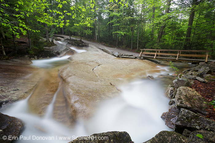 "Franconia Notch State Park - The Pemigewasset River in the area of ""The Basin"" viewing area in Lincoln, New Hampshire during the spring months."