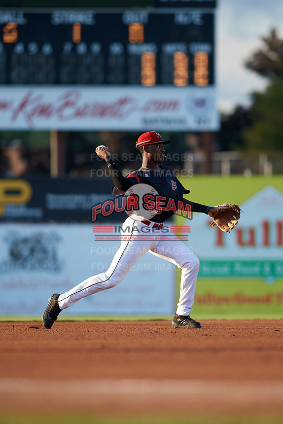 Batavia Muckdogs shortstop Demetrius Sims (55) throws to first base for the out during a game against the Mahoning Valley Scrappers on August 18, 2017 at Dwyer Stadium in Batavia, New York.  Mahoning Valley defeated Batavia 8-2.  (Mike Janes/Four Seam Images)