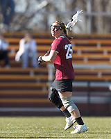 Harvard University midfielder Danielle Tetreault (25) looks to pass.
