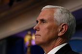United States Vice President Mike Pence listens as US President Donald J. Trump, unseen, speaks during a news conference at the White House in Washington D.C., U.S. on Monday, April 20, 2020. <br /> Credit: Tasos Katopodis / Pool via CNP