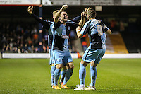 Paul Hayes of Wycombe Wanderers (right) celebrates scoring his team's second goal against Luton Town to make it 0-2 with Garry Thompson of Wycombe Wanderers (centre) during the Sky Bet League 2 match between Luton Town and Wycombe Wanderers at Kenilworth Road, Luton, England on 26 December 2015. Photo by David Horn.