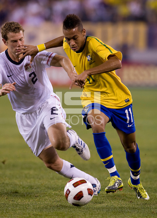 Jonathan Spector (2) of the USMNT tries to close down Neymar (11) of Brazil during an international friendly at the New Meadowlands Stadium in East Rutherford, NJ. Brazil defeated the USMNT, 2-0.