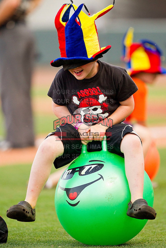 A young fan competes in a between innings contest during the Carolina League game between the Kinston Indians and the Winston-Salem Dash at BB&T Ballpark on June 4, 2011 in Winston-Salem, North Carolina.   Photo by Brian Westerholt / Four Seam Images