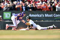 Clemson Tigers third baseman Weston Wilson (8) fields the ball and applies a tag as Jordan Gore (15) slides in safely during a game against the South Carolina Gamecocks at Fluor Field February 28, 2015 in Greenville, South Carolina. The Gamecocks defeated the Tigers 4-1. (Tony Farlow/Four Seam Images)