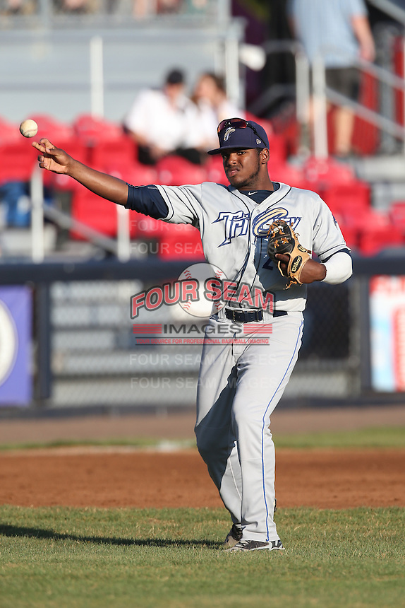 Carlos Belen (24) of the Tri-City Dust Devils makes a throw during a game against the Vancouver Canadians at Nat Bailey Stadium on July 23, 2015 in Vancouver, British Columbia. Tri-City defeated Vancouver, 6-4. (Larry Goren/Four Seam Images)