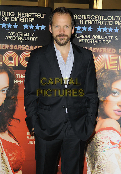 Peter Sarsgaard<br /> 'Lovelace' special screening at the Mayfair Hotel, London, England.<br /> 12th August 2013<br /> half length black suit jacket beard facial hair grey gray shirt hands in pockets <br /> CAP/CAN<br /> &copy;Can Nguyen/Capital Pictures